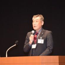 竹内保険担当理事の講演風景